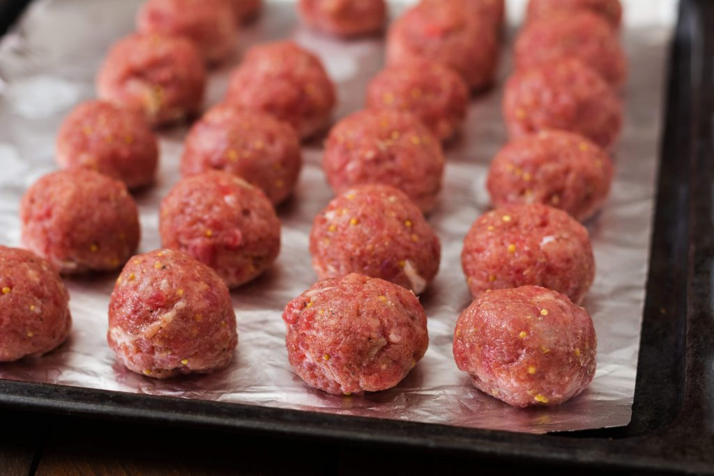 These Low Carb Mozzarella Stuffed Meatballs are a fun twist on a classic recipe - and modified to be a THM:S! Serve these as a party appetizer or a meal served over Miracle Noodles.