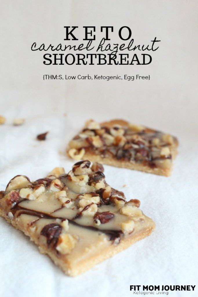 These Keto Shortbread cookies are layered with caramel and hazelnuts for the ultimate low-carb treat.  This recipe is included in my Complete Keto Holiday Cookbook, which is free, and releases 10/15/2018.