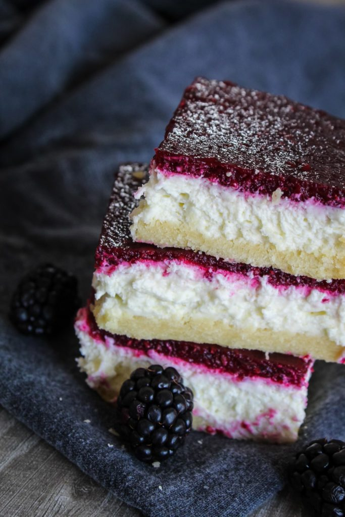 Delicious Keto Blackberry Cheesecake Bars (also known as Blackberry Bliss Bars) are easy, convenient and will fool even family and friends who aren't keto!