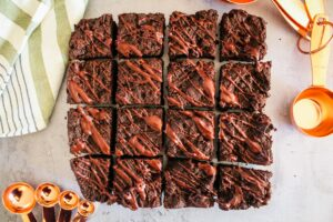 These are the most delicious Keto Brownies.  With a fudgey texture and fantastic macros, these brownies are easy enough to make that you'll want to keep the recipe in your dessert rotation.