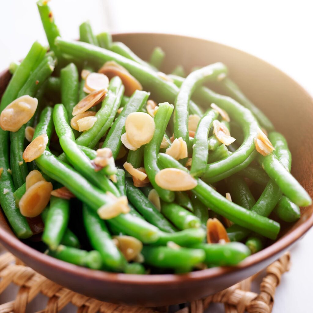 This simple side dish is a wonderful choice for your holiday family dinner.  Originally created for Easter Dinner, my Bacon Almond Green Beans are packed with healthy fats and nutrients from real, delicious ingredients.