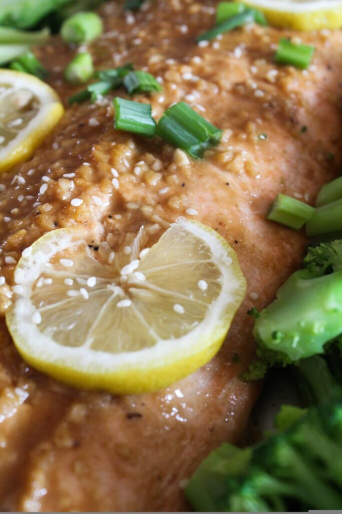 A simple side of salmon glazed with ginger and sesame, that can be prepared on the grill or in the oven.  This Ginger Sesame Salmon recipe is a family favorite, ketogenic, low carb, and a THM:S.