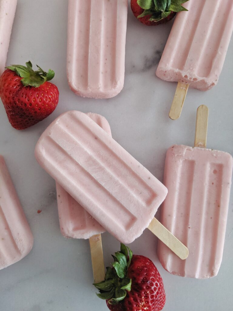 These Keto Popsicles are Strawberry Cheesecake and packed with protein from collagen and cottage cheese!  They're refreshing and sweet, yet healthy enough to eat guilt free!