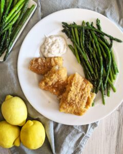 A keto take on traditional fried fish dinner, Keto Air Fryer Breaded Cod is made with quality cod fillets, coated in a crispy low carb breading, and fried in an air fryer.  A modern take on a classic.