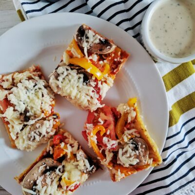 A low dairy, high protein crust that holds up to the heaviest of toppings, Keto Chicken Crust Pizza will become a staple in your household, requiring inexpensive ingredients, and coming together in only 15 minutes.