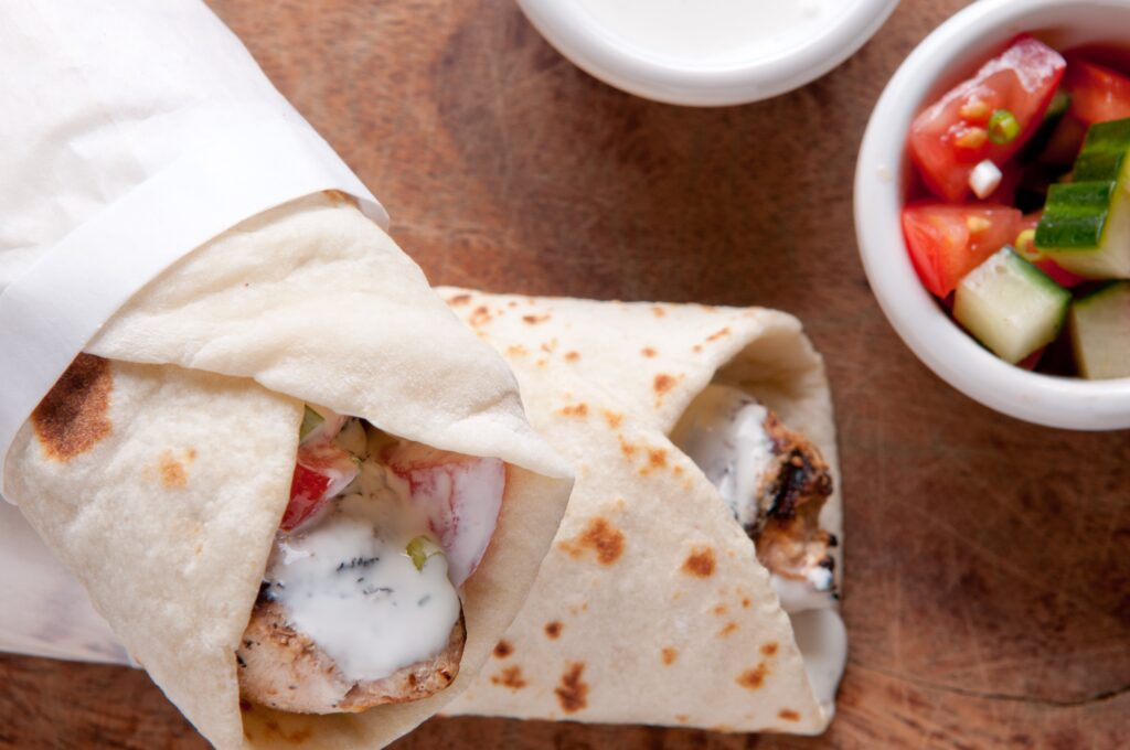 You can make amazing Keto Chicken Gyros at home with clean tzatziki sauce and none of the carbs!  My recipe comes together in 20 minutes and the whole family will enjoy it.