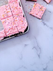 Soft, thick, and fluffy Keto Sugar Cookie Bars topped with a smooth, sweet frosting and sprinkles.  Baked in a sheet pan, these Keto Sugar Cookie Bars are great for a crowd!