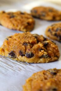 Easy-to-make gluten free and Keto Pumpkin Chocolate Chip Cookies are the perfect dessert for pumpkin spice season!  They're a great way to get that pumpkin flavor without all of the carbs.