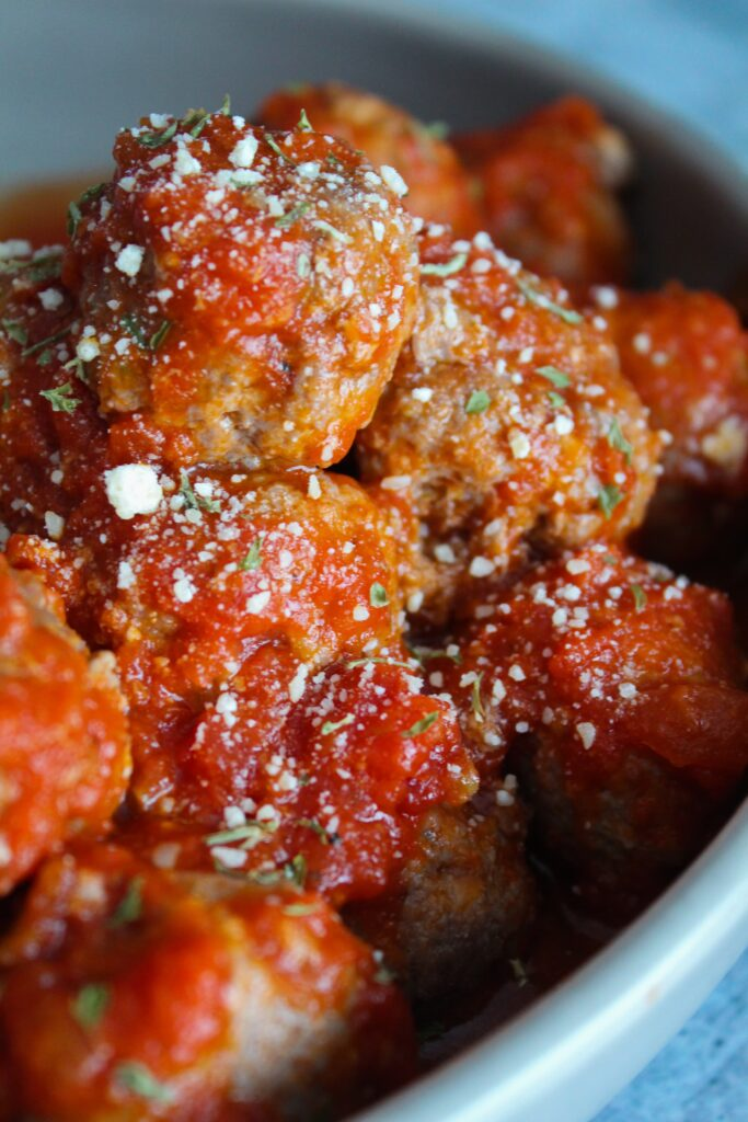 Keto meatballs are one of the simplest dinners you can make with ingredients already on hand!  You can dress them up as swedish meatballs, or keep it simple with sugar free marinara - either way you family will love them!