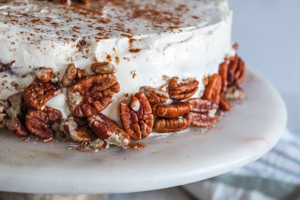 Keto Spice cake with a wonderful cream cheese frosting! One of my absolute favorite fall/winter cakes made keto, and stacked into a show-stopping layer cake.