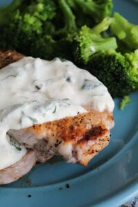 Packed with flavor, Pork Chops with Spinach Cream Sauce are tender, delicious, and an easy dinner the whole family will love!
