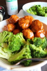 Keto Chicken Meatballs with Sweet and Sour Sauce are the perfect family meal.  Versatile enough to re-purpose into many different meals, moist, and easy to make, Keto Chicken Meatballs are a staple in our house!