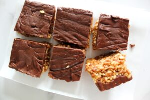 Keto Scotcheroos are a chewy no-bake peanut butter rice krispie bar with a butterscotch chocolate topping. My version is low carb, high protein, ketogenic, and a THM:S.