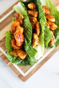 Keto Sesame Chicken is a low carb take on an Asian takeout classic. Battered and air fried (or fried) chicken pieces coated in a sesame sauce made low carb, ketogenic, paleo, sugar free, grain free, and a THM:S