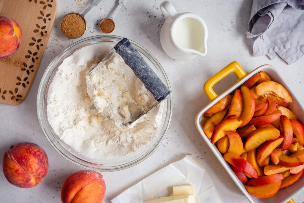 A healthy keto peach cobbler that is made grain free, gluten free, sugar free, ketogenic, and more! Use fresh, in-season peaches for a delicious dessert that's perfect with a scoop of keto ice cream.