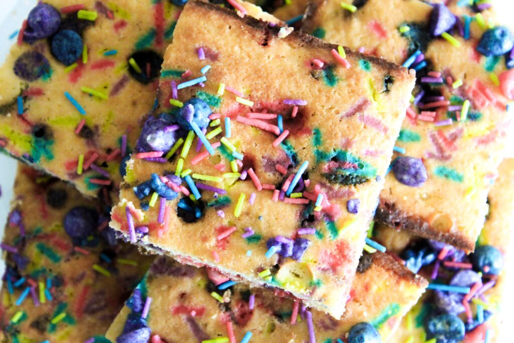 Keto Unicorn Blondies Made from scratch by my daughter's request!  Made with a chewy blondie base, colored keto white chocolate chips, and sugar free sprinkles, these are such a fun dessert!