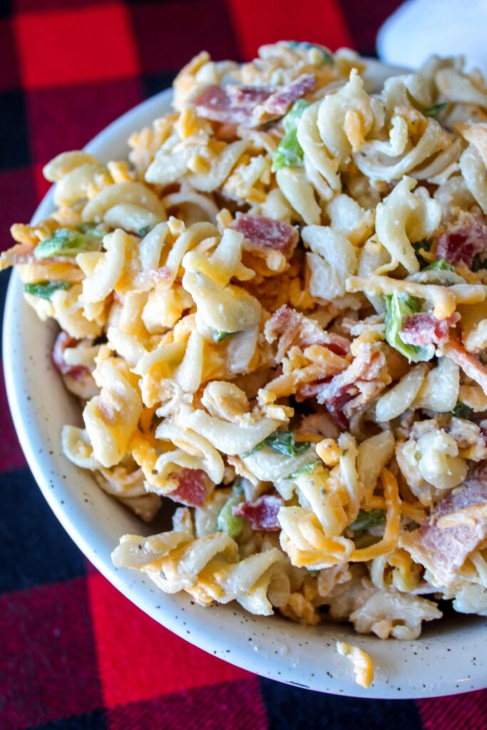 Low Carb Chicken Bacon Ranch Pasta Salad is a delicious lunch dish featuring shredded cheddar cheese, crumbled bacon, chopped green onions, and white meat chicken tossed in mayo and ranch dressing.