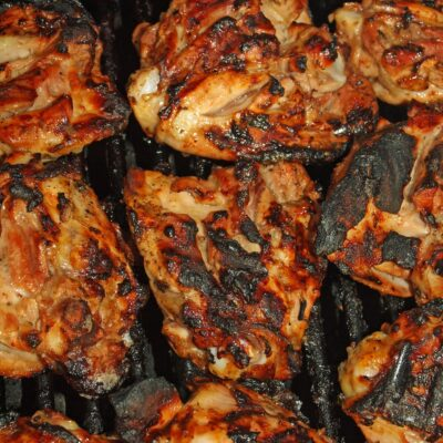 Chicken Thighs coated in a homeade BBQ rub then cooked in a smoker until tender and flavorful. Serve with your favorite barbecue sauce and sides for the perfect food to feed a crowd or outdoor gathering!