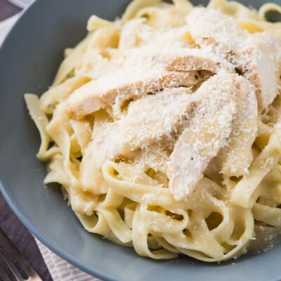 Creamy homemade Keto Alfredo Sauce made from garlic, parmesan, and cream. The sauce is very easy to make low carb or Ketogenic - and tastes so much better than pre-made from the store.