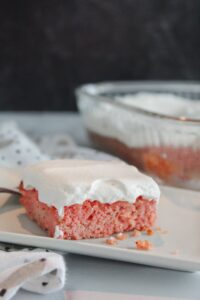 A rich keto strawberry cake with real strawberries baked in!  Top it with even more strawberries, whipped topping (there's a paleo version for you folks) or enjoy it by itself, keto strawberry cake is a delicious way to use up strawberries that have gone soft.