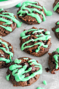 Like eating mint chocolate chip ice cream in cookie form, these Keto Mint Chocolate Chip Cookies in a warm, fresh-from-the-oven cookie! They're soft chocolate cookies, with sugar free mint chocolate chips, and drizzled with mint colored icing!  Delicious and healthy!