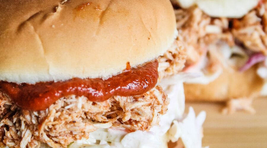 When warm weather comes around, I start putting easy, refreshing meals in the rotation, including hese Low Carb Pulled BBQ Chicken Sandwiches. Pulled chicken with keto barbecue sauce, and keto coleslaw on a low carb bun - these are easy to put together and great during hot weather.