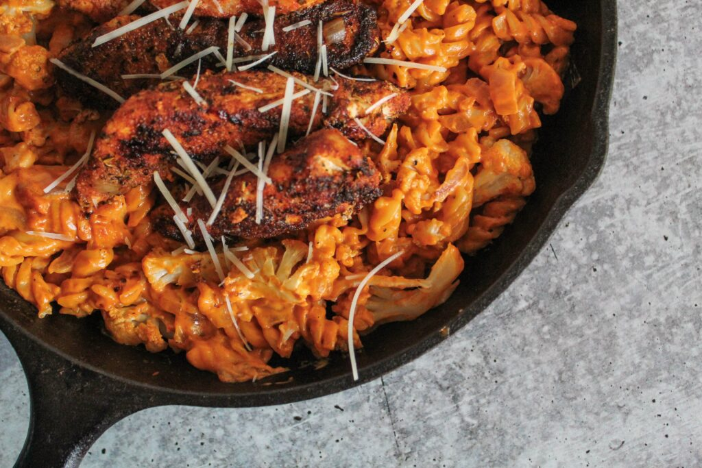 Chili's copycat recipe made at home - and Keto! Keto Cajun Chicken Pasta features an amazingly creamy and spicy alfredo sauce, crispy chicken, and 4 keto - friendly noodle options.