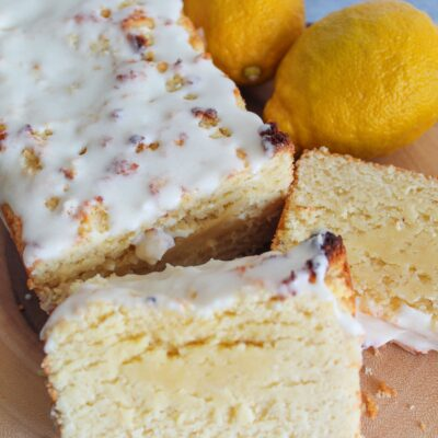 This moist Keto Lemon Loaf is fluffy, tangy & sweet, and very easy to make.  It requires not special ingredients but still hangs onto the flavor and texture of certain chain's beloved lemon loaf that goes so well with coffee.  Top it with a sweet lemon glaze for a delicious treat!