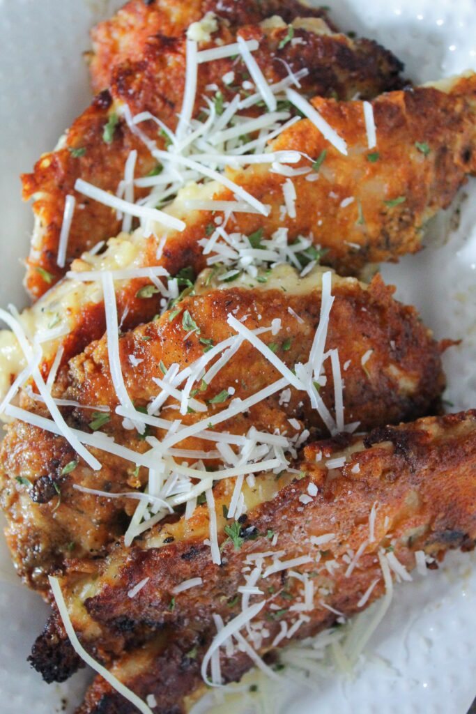 Crispy Low Carb Parmesan Chicken Tenders are a quick and easy dinner the whole family will like! Eat them on their own, with pasta sauce, or over your favorite low-carb pasta alternative. Crispy, crunchy, and keto-friendly.
