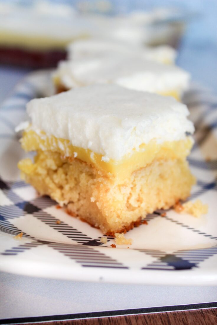 Keto Lemon Curd Cake is a delicious summer treat. Keto Lemon Cake is poked then covered with Keto Lemon Curd, then with lightly sweetened whipped cream. This dessert is very simple and incredibly delicious!