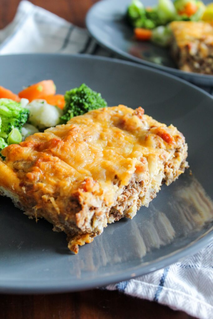 Keto Bacon Cheeseburger Casserole is a quick-prep dinner that I love to make ahead, freeze, and reheat for busy days or meal portioning. Made with inexpensive ground beef, eggs, cheese, and a sauce that tastes exactly like a cheeseburger, it's a convenient burger without the bun!